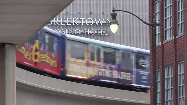 detroit profile low angle shot high rise office building train along in front of greek town casino hotel derelict factory building various shots... - casino floor stock videos & royalty-free footage