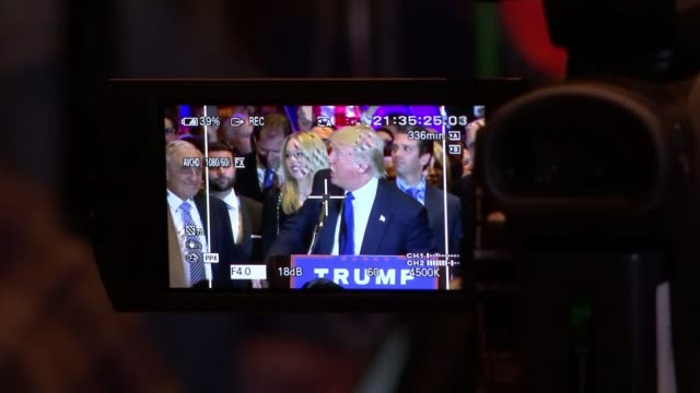 donald trump and hillary clinton win in new york donald trump being filmed by video camera ivanka trump and melania trump on stage close shot of... - elezione video stock e b–roll