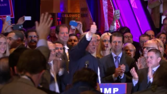 Donald Trump and Hillary Clinton win in New York Trump Tower **Music heard SOT** Donald Trump waving and celebrating with supporters at rally