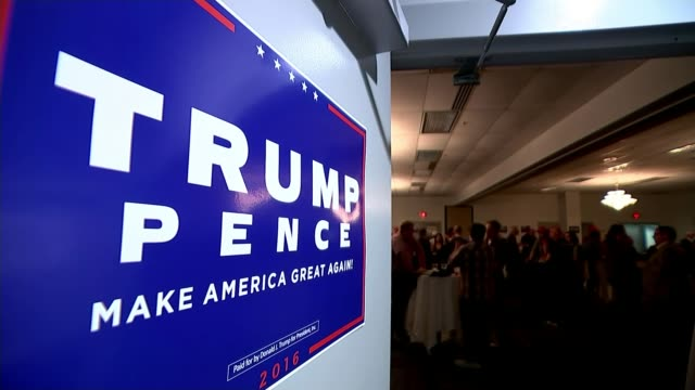 donald trump officially nominated as republican candidate **music heard sot** pull focus 'trump pence' poster zoom in 'make america great again' cap... - ノミネート点の映像素材/bロール