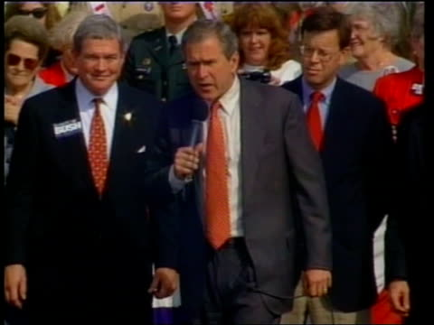 presidential election: final week of campaigning:; c)c4n: david smith itn usa: missouri: colombia: ext tgv george w. bush onto stage as waves to... - dick cheney stock videos & royalty-free footage