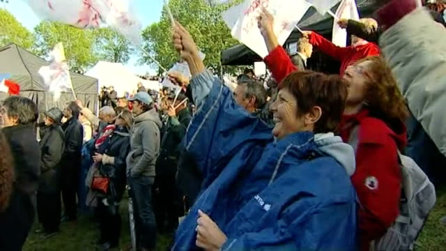 francois hollande ahead in opinion poll france bordeaux sea of flags waved at election rally for francois hollande as hollande onto stage behind... - gironde stock videos and b-roll footage