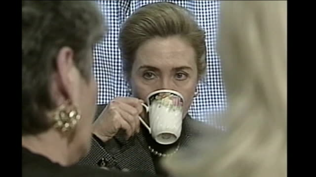 hillary clinton backtracks on bosnia story 1990's hillary clinton drinking tea with unidentified women during trip to northern ireland and photocall... - david trimble stock videos and b-roll footage