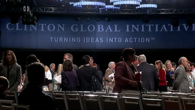 hillary clinton in cronyism row usa new york int **bill clinton speaking overlaid sot** people arriving at clinton global initiative annual meeting... - jahreshauptversammlung stock-videos und b-roll-filmmaterial