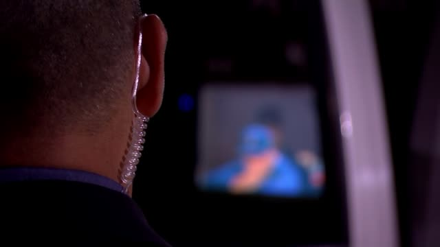 Latest developments Back view of man watching baseball game on television screen