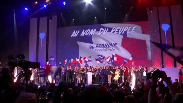 Le Pen fights to reach round two Presidential election Le Pen fights to reach round two Stage at rally crowded with Le Pen supporters Le Pen holding...