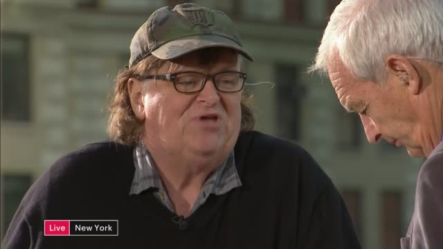 polling day commentary and interviews USA New York Manhattan EXT Michael Moore and Betsy McCaughey rooftop STUDIO interview SOT