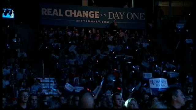 polling day int rock band performing at rally to warm up the audience sot gv audience waving glowing sticks pom pom being waved mitt and ann romney... - 2012 united states presidential election stock videos & royalty-free footage