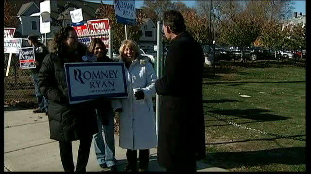 polling day massachusetts belmont track past republican supporter with placard and other placards and banner reporter with republican supporters vox... - 2012 united states presidential election stock videos & royalty-free footage