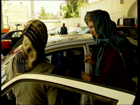 presidential election preview iran tehran gv rally car pulling up to starting line laleh seddith just visible in driver's seat as she speaks to... - proton stock videos and b-roll footage