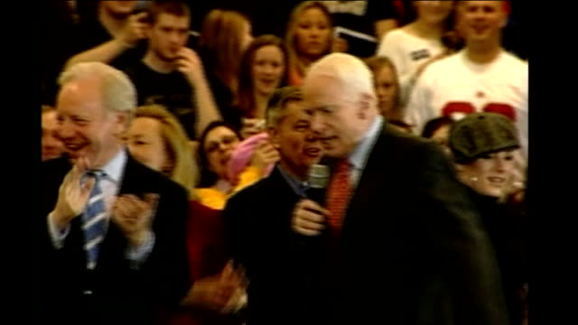 buildup to 'Super Tuesday' Connecticut INT Man putting up banner as sets up rally for Senator John McCain Senator John McCain speaking on stage at...
