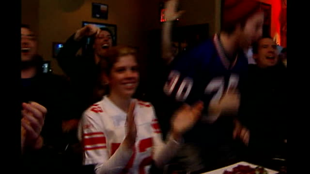 buildup to 'super tuesday' new york new york giants fans cheering super bowl victory in bar missouri st louis clinton signing autographs and posing... - united states presidential election stock videos & royalty-free footage