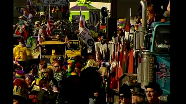 buildup to 'super tuesday' usa missouri st louis ext crowds of american people and floats in street during carnival to celebrate mardi gras man... - gras stock videos and b-roll footage
