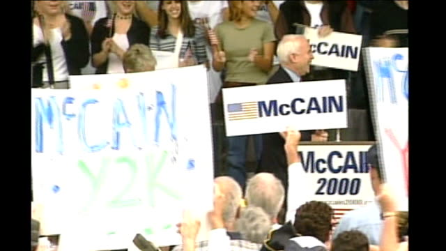 hillary clinton and barack obama neck and neck after super tuesday tx mccain and wife cindy along onto stage as applauded by supporters with placards... - united states presidential election stock videos & royalty-free footage