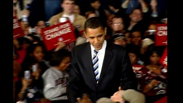 stockvideo's en b-roll-footage met 'super tuesday' voting begins dates and locations unknown int obama on stage at campaign rally shaking hands with cheering crowds of supporters who... - 2008