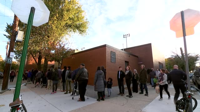presidential election: recount campaign; november 2016 usa: ext various shots of people queuing up to vote in presidential election outside polling... - waiting in line stock videos & royalty-free footage