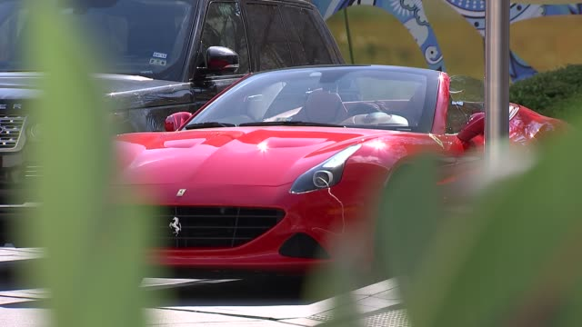 stockvideo's en b-roll-footage met super tuesday eve campaigning in texas street scenes / gvs us capial advisors office building and name sign/ red ferrari sports car parked in car... - street name sign