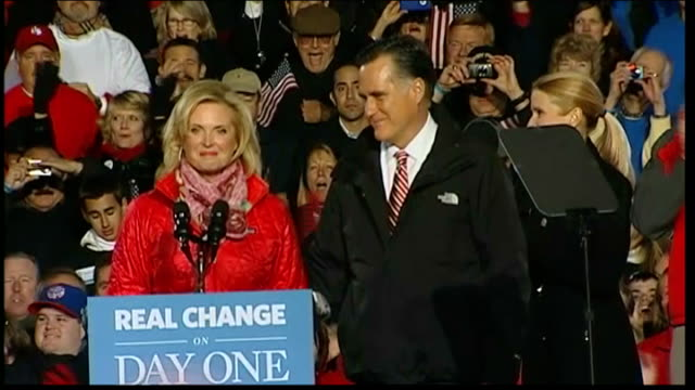 three days to go usa mitt romney down steps of aircraft carrying his sleeping grandson night ends mitt romney and his wife ann romney waving to... - united states presidential election stock videos & royalty-free footage