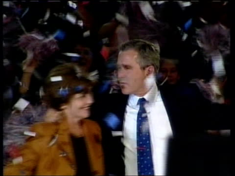 stockvideo's en b-roll-footage met too close to call itn usa florida jacksonville george w bush and wife laura bush as ticker tape falls - george w. bush