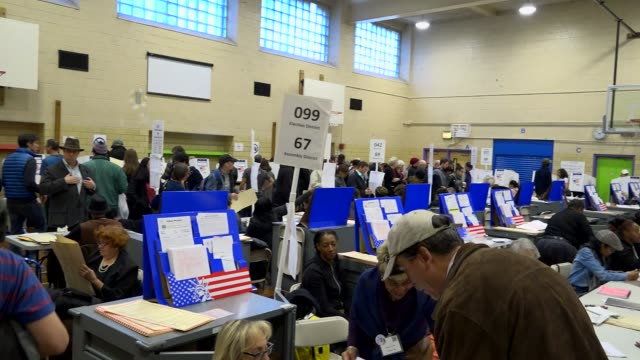 presidential election voters casting their votes during mid day / upper west side ps 163 west 96th street manhattan new york city usa - wahllokal stock-videos und b-roll-filmmaterial