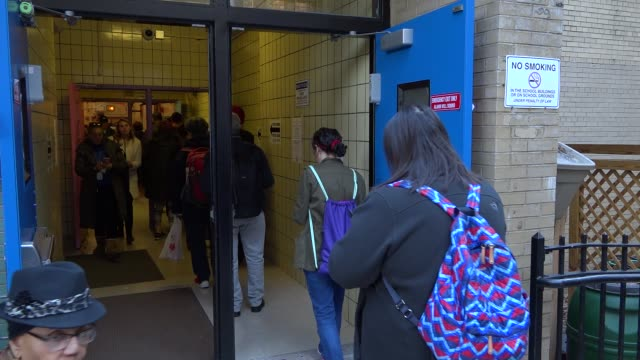 Presidential election voters entering and exiting voting station during mid day / Upper West Side PS 163 West 96th Street Manhattan New York City USA