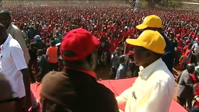 presidential election: voting takes place; date unknown; ext various of tsvangirai on stage during rally supporters at election rally - political rally stock videos & royalty-free footage