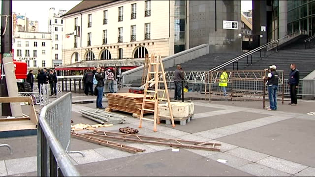 voting underway FRANCE Paris EXT Workmen setting up barriers Wide shot Place de la Concorde including fountain and the Obelisk Nearly empty street...