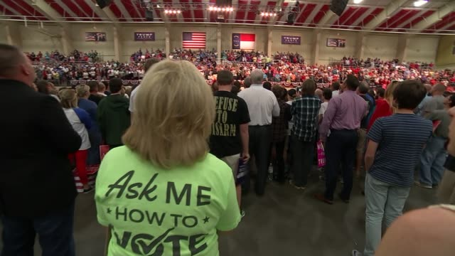 vox pops trump supporters at rally trump supporters cheering and watching rally / prayers / national anthem / woman giving out trump stickers /... - lock stock videos and b-roll footage