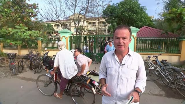 counting begins as aung san suu kyi expected to win sweeping victory insein township people along through crowded market view of street from car as... - political prisoner stock videos & royalty-free footage