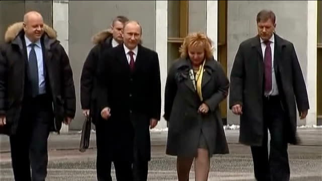 exit polls show victory for vladimir putin day vladimir putin and wife lyudmila putina towards with others - presidential election stock videos and b-roll footage