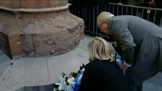 national front leader refuses to back nicolas sarkozy france paris ext marine le pen and father jeanmarie le pen laying flowers at statue of joan of... - national front stock videos & royalty-free footage