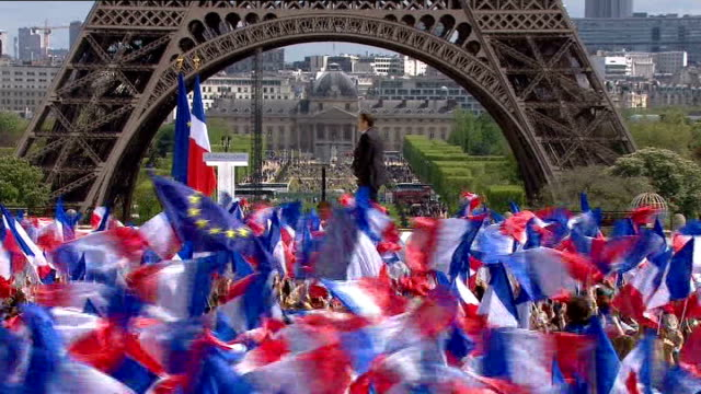 national front leader refuses to back nicolas sarkozy france paris ext french flags waved by crowd of supporters at rally for french president... - national front stock videos & royalty-free footage