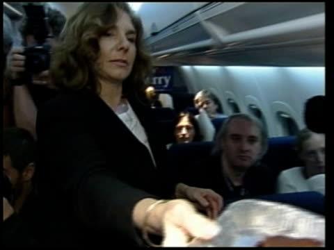 Senator John Kerry/ Hillary Clinton ITN Kerry and family down from aircraft TILT DOWN INT AIRCRAFT CMS Teresa Heinz Kerry serving brownies to...
