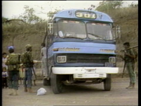 Presidential elections UPITN MS Guerrillas stop bus on road MS Money and ID cards handed over to guerrillas MS People off bus