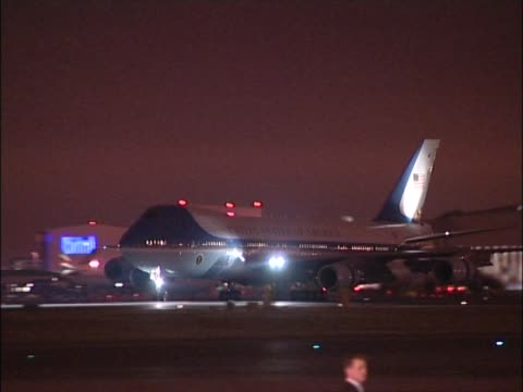 US presidential jet Air Force One lands at Heathrow at night for start of state visit to UK by President Bush