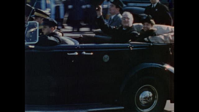 vídeos de stock e filmes b-roll de presidential motorcade drives back to the white house after third inauguration of president roosevelt - primeira dama