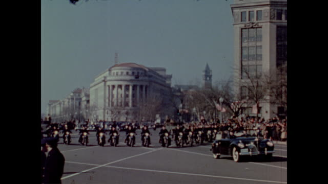 Presidential motorcade leaves the White House and drives down the crowded streets during President Roosevelt's third inauguration parade