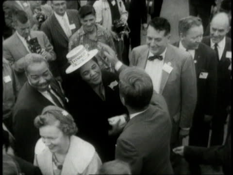 Presidential nominee JFK greeting a crowd and shaking hands / United States