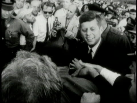 presidential nominee jfk walking through a crowd and shaking hands / united states - john f. kennedy politik stock-videos und b-roll-filmmaterial