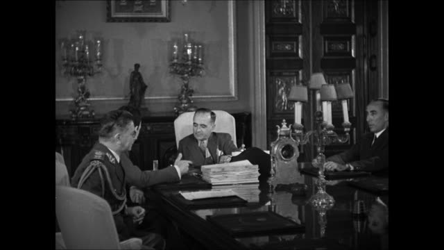 presidential palace gates entrance rio de janeiro int vs brazilian president getulio d vargas at table talking w/ officials vargas laughing ext ms... - 1944 stock videos and b-roll footage