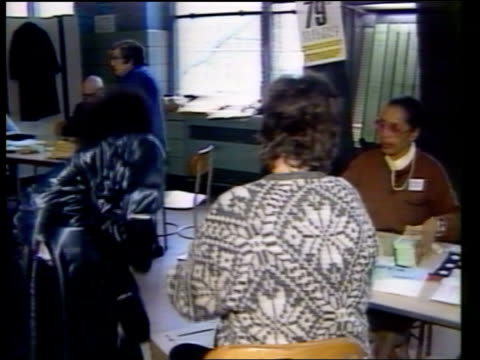 democrats vote in new york primary usa new york polling station woman signs poll card pull out as she walks along away to booth in bv zoom in polling... - voting booth stock videos & royalty-free footage