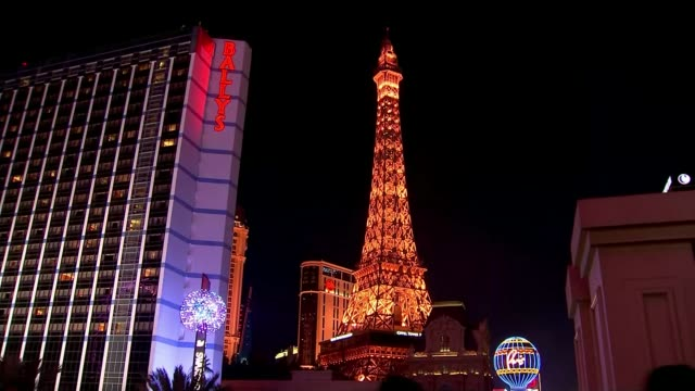 Donald Trump wins in Nevada T23021623 2322016 USA Nevada Las Vegas EXT Caesars Palace lit up at night Traffic and lights on strip Eiffel Tower lit at...