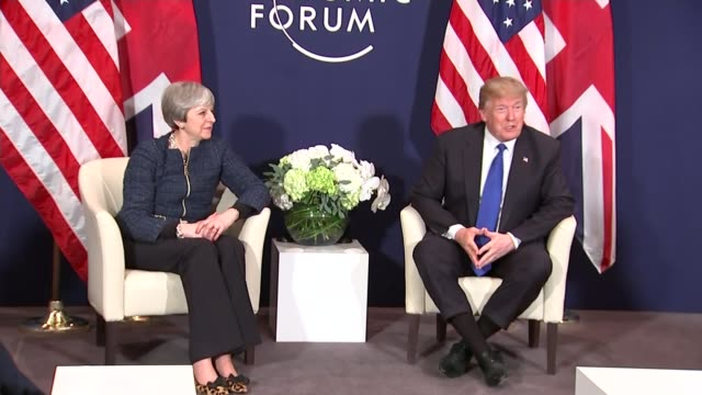 Theresa May comments / further reaction SWITZERLAND Davos World Economic Forum INT Theresa May MP and Donald Trump seated together at photocall/...