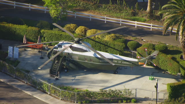 ws aerial pov presidents' helicopter at richard nixon presidential library and museum / yorba linda, california, united states - president stock videos & royalty-free footage