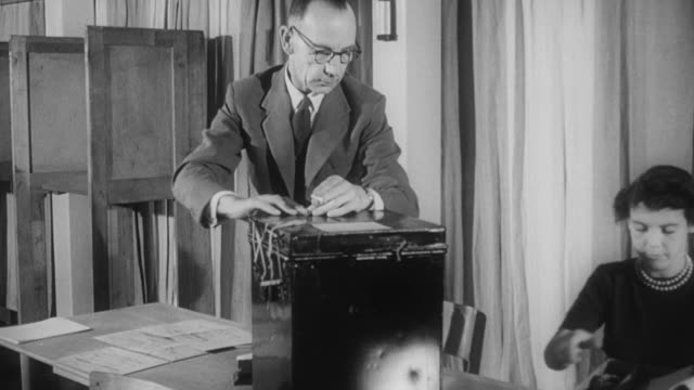 1960 b/w presiding officer closing the polling station and delivering the ballot box / united kingdom - voting ballot stock videos and b-roll footage