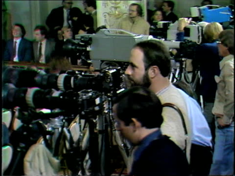 press conference continues for u.s. president elect ronald reagan's cabinet nominees. audience and press pool, group of adult caucasian male press... - pressekonferenz stock-videos und b-roll-filmmaterial