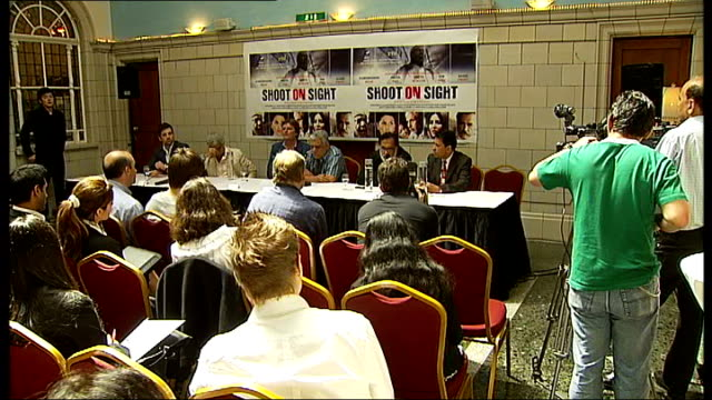 press conference for launch of film 'shoot on sight'; england: london: int **some flash photography** general view of press conference for film... - scriptwriter stock videos & royalty-free footage