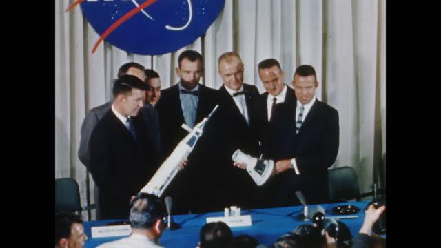 press conference for seven astronauts, lieutenant malcolm s. carpenter, captain leroy g. cooper, lieutenant colonel john h. glenn, captain virgil i.... - alan b. shepard jr stock videos & royalty-free footage