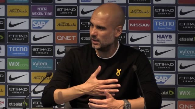 press conference with manchester city manager pep guardiola following their 61 win over huddersfield town he talks about the performance of david... - 後を追う点の映像素材/bロール