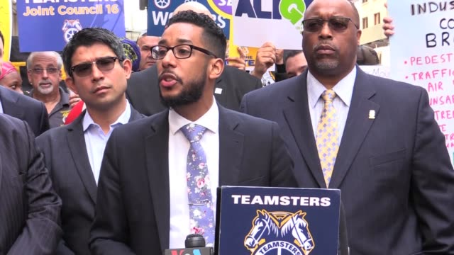 press conference with teamsters and city council members outside city's business integrity commission seeking to strip license of sanitation salvage... - driver's license stock videos and b-roll footage